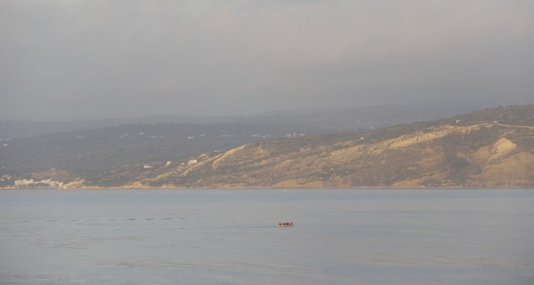 Picture of boat people near Lesbos island
